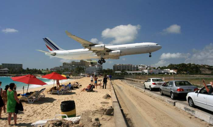 Airplane spotting in St. Maarten on Maho beach